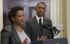 US President Barack Obama looks on as his nominee for US Attorney General, Loretta Lynch (L), speaks during an event at the White House in Washington, DC, 8 November, 2014. Picture: AFP.