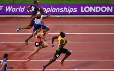 Jamaica's Usain Bolt competes in the heats of the men's 100m athletics event at the 2017 IAAF World Championships at the London Stadium in London on 4 August, 2017. Picture: AFP.