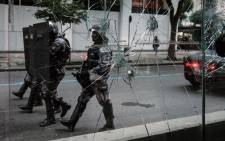 The military police make a formation to walk toward protesters during the nationwide strike called by unions opposing austerity reforms in Rio de Janeiro, Brazil, on 28 April, 2017. Picture: AFP.