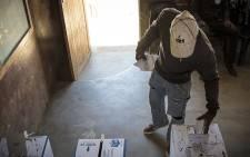 FILE: A voter places his vote into a ballot box at a school in Matsila. Picture: Thomas Holder/EWN.