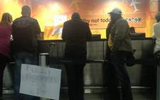 Passengers at OR Tambo International Airport in Johannesburg try to book with other airlines after 1time filed for liquidation on 2 November, 2012. Picture: EWN.