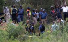 South African police escort illegal miners arrested for illegal mining and trespassing on 7 January, 2014 in Johannesburg. Picture: AFP.