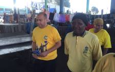 ANC provincial secretary Faiez Jacobs introducing ward 37 candidate Templeton Mgxekeni to residents at the Nyanga taxi rank. Picture: Xolani Koyana/EWN.
