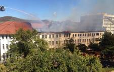 Firefighters try and bring a fire at Stellenbosch University's Van der Sterr Building under control on 22 February, 2015. Picture: iWitness.