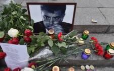 Flowers and candles are set in front of a portrait of Boris Nemtsov during a memorial ceremony on Independence Square in Kiev on 28 February, 2015. Picture: AFP.