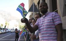Protesters form a human chain outside Parliament in order to protest against President Jacob Zuma. Picture: Cindy Archillies/EWN.