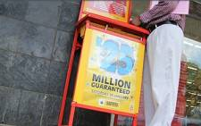 FILE: A man fills in a lotto form outside a lotto stand in Pretoria. Picture: EWN.