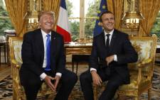 French President Emmanuel Macron (R) and US President Donald Trump (L) smile during their meeting at the Elysee Palace in Paris on 13 July 2017. Picture: AFP.