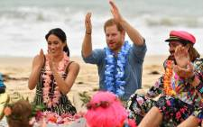 "Britain's Prince Harry and his wife Meghan, Duchess of Sussex attend a ""Fluro Friday"" session run by OneWave, a local surfing community group who raise awareness for mental health and wellbeing, at Sydney's iconic Bondi Beach on 19 October, 2018. Picture: AFP."