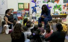 Michelle Obama visits the low-income school to read stories to kids on her way to promote her new memoir, 'Becoming',  at The Forum.