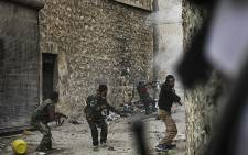 FSA fighters battle with regime loyalist soldiers in Syria's northern city of Aleppo. AFP/Javier Manzano