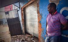 Mohammad Omar, a Somali national, lost stock worth R280,000 after looters broke into his shop. Picture: Thomas Holder/EWN.