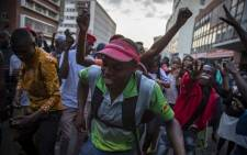 MDC supporters celebrate outside the MDC headquarters what was earlier allegedly announced by their leadership as a win for the 2018 Zimbabwe elections. Picture: Thomas Holder/EWN