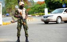 FILE:A soldier takes position in Abuja on 6 May 2014. Picture: AFP.