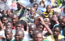 FILE: Striking Lonmin workers discuss a wage increase offer in Marikana, North West, on 14 September 2012. Picture: EWN.