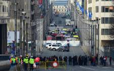 FILE. A security perimeter has been set, on 22 March, 2016 near Maalbeek metro station in Brussels, after a blast at this station near the EU institutions caused deaths and injuries. Picture: AFP.