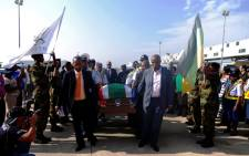 A coffin with the remains of prolific South African author and journalist Nat Nakasa arrives at Durban's King Shaka International Airport on Tuesday, 19 August 2014. Picture: Sapa.