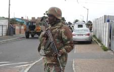 FILE: SANDF soldier on patrol in Manenberg. The military has released their soldiers to help stabilise gang hotspots, while law enforcement agencies conducted raids in the area. Picture: Bertram Malgas/EWN