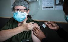 A doctor gives the thumbs up as she's vaccinated at the Steve Biko Academic Hospital on 17 February 2021. Abigail Javier/Eyewitness News