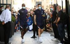 France's defender Moussa Sissoko (L) and France's goalkeeper Hugo Lloris leave their hotel to go to a training session in Bucharest on June 26, 2021 during the UEFA EURO 2020 European Football Championship. Picture: Franck Fife / AFP.