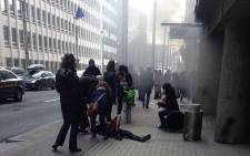 People stream out of  the Maalbeek Metro station in Brussels following a suspected terrorist attack. Picture: Ron Eisenmann.