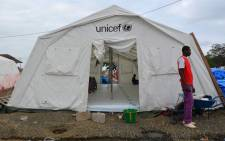 A man stands next to a tent set up to treat Ebola patients on 12 August, 2014 in Monrovia. Picture: AFP.