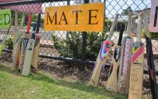 Cricket bats and signs are placed outside St. Patricks Primary School hours before the funeral of Australian batsman Phillip Hughes in his home town of Macksville in northern New South Wales, on 3 December, 2014. Picture: AFP.