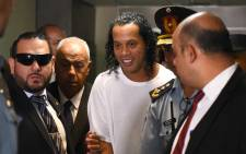 Retired Brazilian football player Ronaldinho (C) arrives at Asuncion's Justice Palace to testify about his irregular entry to the country, in Asuncion, on 6 March 2020. Picture: AFP.