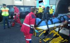 Emergency personnel attend to the victims of a collision between a bus and a taxi on Koeberg Road in the Western Cape.