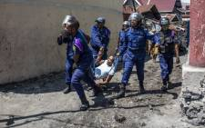 Congolese National Police arrest a man at Majengo neighbourhood in Goma, on 27 December 2018, during a demonstration against the postponement, announced the day before by the Congolese national committee, of the general elections in this area. Picture: AFP.