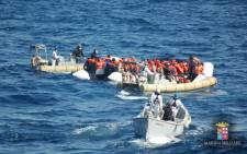 This handout picture released by the Italian Navy shows a rescue operation of migrants and refugees at sea, off the coast of Sicily, on 16 March 2016. Picture: Marina Militare/AFP.