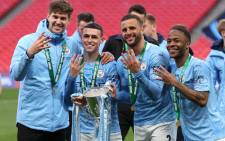 Manchester City players celebrate their English League Cup victory over Tottenham Hotspur at Wembley Stadium in London on 25 April 2021. Picture: @ManCity/Twitter