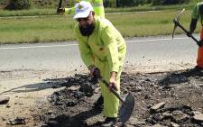 Gauteng MEC for Roads and Transport Ismail Vadi repairing a damaged section of the N14 road on 18 March 2014. Picture: Masego Rahlaga/EWN.