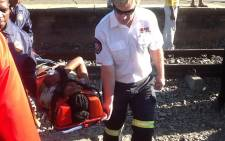 FILE: Paramedics remove a woman who got injured following a train collision at Denver Station on 28 April 2015. Picture: Gia Nicolaides/EWN.