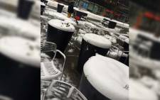 FILE: Snow covers tables and chairs at a sidewalk restaurant in New York after a blizzard swept across the northeastern United States. Picture: Annwen Quilliam