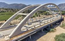 The newly completed Ashton Arch is South Africa's first concrete tied arch bridge constructed using a transverse launching method.  (ashton-arch.co.za)