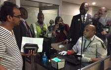 Home Affairs Minister Malusi Gigaba inspects the new biometric capturing pilot project at OR Tambo Interbational Airport. Picture: Vumani Mkhize