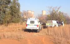 Police investigate the scene where a top Johannesburg policeman's body was found near Hammanskraal, just outside Pretoria on 18 June 2013. Picture: Christa van der Walt/EWN.