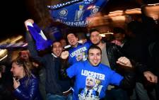 Leicester City fans celebrate their team becoming the English Premier League champions in central Leicester, eastern England, on 2 May 2016 after Chelsea held Tottenham Hotspur to a 2-2 draw. Picture: AFP