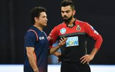 FILE: In this file photo taken on 17 April 2018 Royal Challengers Bangalore captain Virat Kohli (R) speaks with Mumbai Indians team mentor Sachin Tendulkar before the start of the 2018 Indian Premier League (IPL) Twenty20 cricket match between Mumbai Indians and Royal Challengers Bangalore at the Wankhede stadium in Mumbai. Picture: AFP