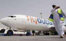 FILE: A picture taken on 18 May 2009 shows the first of flydubai's fifty Boeing 737-800 Next Generation aircraft sitting on the tarmac at Dubai airport. All 62 people on board a flydubai Boeing 737 were killed when the plane crashed and burst into flames as it was landing in Rostov-on-Don, in Southern Russia, on 19 March 2016. Picture: AFP.