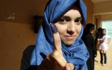 A Libyan woman shows her ink-stained finger after casting her vote at a polling station in the eastern city of Benghazi on July 7, 2012, in the country's first national election after more than four decades of dictatorship. Picture: AFP
