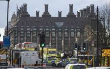 Members of the emergency services work on Westminster Bridge, alongside the Houses of Parliament in central London on 22 March 2017 during an emergency incident. Picture: AFP