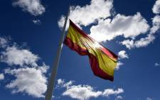 A Spanish national flag flies at half mast at Plaza de Colon for the victims of the crash of an Airbus A320 in Madrid on 25 March, 2015. Picture: AFP.