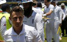 England player James Taylor (front) and other team members leaving the grounds at the end of the first Test match between South Africa and England at Kingsmead Stadium in Durban on 30 December 2015. Picture: Marco Longari/AFP.