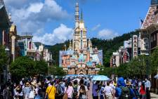 Visitors and members of the media walk in Hong Kong's Disneyland on June 18, 2020, after the theme park officially reopened following nearly five months of closure in a fresh boost for a city that has largely managed to defeat the COVID-19 coronavirus. Picture: AFP.