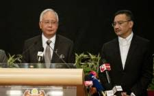 FILE: It's believed $681 million was deposited into Prime Minister Najib Razak (R) personal bank account. Picture:AFP.
