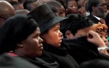 Late Gauteng MEC for Economic Development Nkosiphendule Kolisile's wife (centre) at her husband's memorial service at the Johannesburg City Hall on 24 July 2013. Picture: Sebabatso Mosamo/EWN