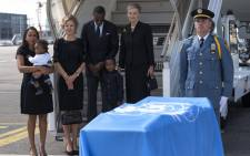 FILE: Nane Annan (second from right), the spouse of recently-deceased former secretary-general Kofi Annan, stands alongside her family in Geneva next to Mr Annan's remains. Picture: United Nations Photo.