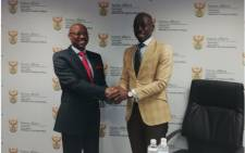 Outgoing Home Affairs Director-General Mkuseli Apleni (right) and Minister Malusi Gigaba shake hands after the minister announced the DG's resignation in Pretoria. Picture: @SAgovnews/Twitter